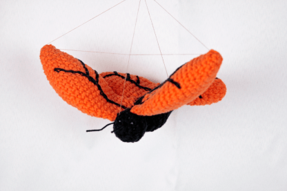 vliegende vlinder haken